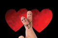 Composite image of fingers crossed like couple