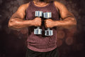 Composite image of fit man exercising with dumbbell Royalty Free Stock Photo
