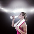 Composite image of fit woman drinking water Royalty Free Stock Photo