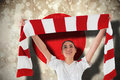 Composite image of football fan waving red and white scarf against japan flag Royalty Free Stock Photography