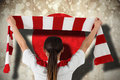 Composite image of football fan waving red and white scarf against japan flag Royalty Free Stock Photos