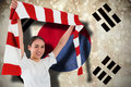 Composite image of football fan waving red and white scarf against south korea flag Stock Images