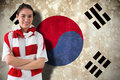 Composite image of football fan in white wearing scarf against south korea flag Royalty Free Stock Image