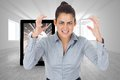 Composite image of furious businesswoman gesturing against bright room with opened windows Stock Image