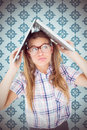 Composite image of geeky hipster holding her laptop over her head Royalty Free Stock Photo