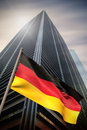 Composite image of germany national flag against low angle view skyscraper Stock Image