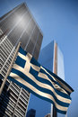 Composite image of greece national flag against low angle view skyscrapers Stock Image