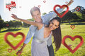 Composite image of happy couple with arms outstretched at park against valentines day Royalty Free Stock Photography