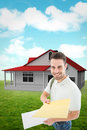 Composite image of happy derivery man giving envelop against blue sky Royalty Free Stock Photo