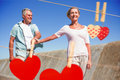 Composite image of happy senior couple walking on the pier Royalty Free Stock Photo
