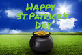 Composite image of happy st patricks day against sunny green landscape Royalty Free Stock Image