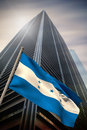 Composite image of honduras national flag against low angle view skyscraper Royalty Free Stock Images
