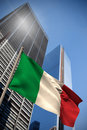 Composite image of italy national flag against low angle view skyscrapers Royalty Free Stock Images