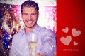 Composite image of man offering champagne against cute valentines message Stock Photo