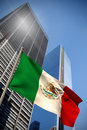 Composite image of mexico national flag against low angle view skyscrapers Stock Photos