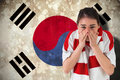 Composite image of nervous football fan looking ahead against south korea flag Stock Photography