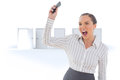 Composite image of offended businesswoman screaming and throwing her mobile phone Royalty Free Stock Photo
