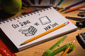 Composite image of old school vs new school doodle against students table with supplies Royalty Free Stock Photo