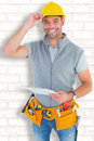 Composite image of portrait of smiling manual worker holding clipboard Royalty Free Stock Photo