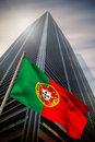 Composite image of portugal national flag against low angle view skyscraper Stock Photos