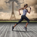 A Composite image of pretty fit blonde jogging Royalty Free Stock Photo