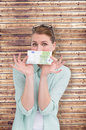 Composite image of pretty woman showing an one hundred euro note Royalty Free Stock Photo