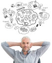 Composite image of relaxed mature businessman with hands behind head against brainstorm Royalty Free Stock Photography