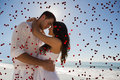 Composite image of romantic couple embracing against red love hearts Stock Photos