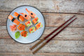 Composite image of salmon sushi served in plate Royalty Free Stock Photo