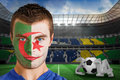 Composite image of serious young algeria fan with face paint against large football stadium brasilian fans Stock Images