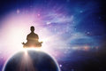 Composite image of silhouette man doing meditation Royalty Free Stock Photo