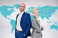 Composite image of smiling business people back to back against world map Royalty Free Stock Photography
