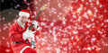 Composite image of smiling santa claus playing guitar while dancing Royalty Free Stock Photo
