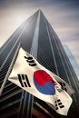 Composite image of south korea national flag against low angle view skyscraper Royalty Free Stock Images