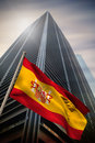 Composite image of spain national flag against low angle view skyscraper Royalty Free Stock Photos