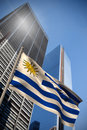 Composite image of uruguay national flag against low angle view skyscrapers Stock Image