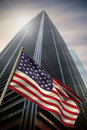 Composite image of usa national flag against low angle view skyscraper Stock Photo