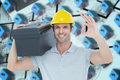 Composite image of worker carrying tool box on shoulder while gesturing ok sign against blue d houses in an estate order Royalty Free Stock Photography