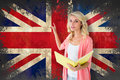 Composite image of young pretty student pointing and reading against union jack flag in grunge effect Stock Images