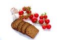 Composition of black bread slices, cherry tomatoes and garlic Royalty Free Stock Photo