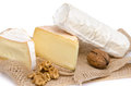 Composition of cheeses on a burlap isolated white Stock Images