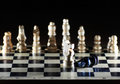 Composition with chessmen on glossy chessboard Stock Photo
