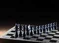 Composition with chessmen on glossy chessboard Stock Photography