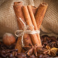 Composition of cinnamon, coffee beans, anise, hazelnuts a Stock Photo