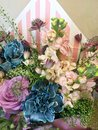 Composition with Colorful. Flowers pink matthiola, white Ranunnculus, eucalyptus, Astrantia, blue carnation, purpl roses. Flowers