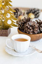 Composition with cup of tea bumps and christmas tree xmas Royalty Free Stock Photo