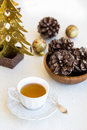 Composition with cup of tea bumps and christmas tree xmas Royalty Free Stock Photography