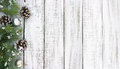 Composition with decorated Christmas tree on white rustic wooden Royalty Free Stock Photo
