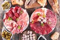 Composition of delicatessen on wood background Royalty Free Stock Photography