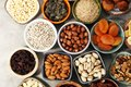 Composition with dried fruits and assorted healthy nuts Royalty Free Stock Photo